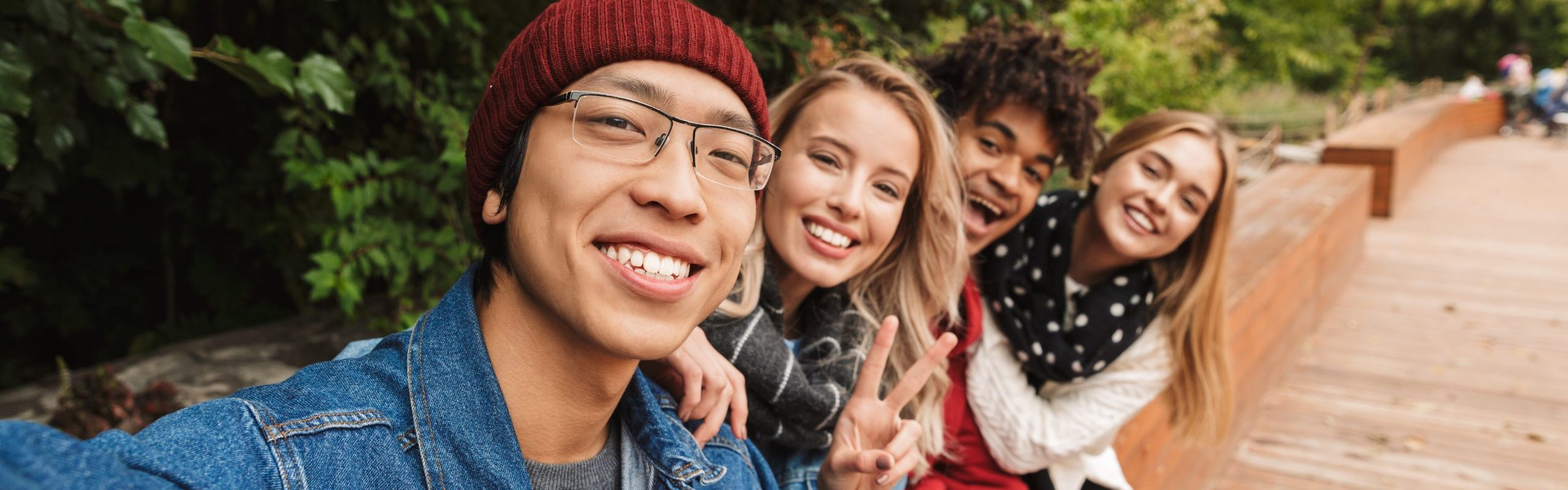 teens smiling at the camera, taking a selfie